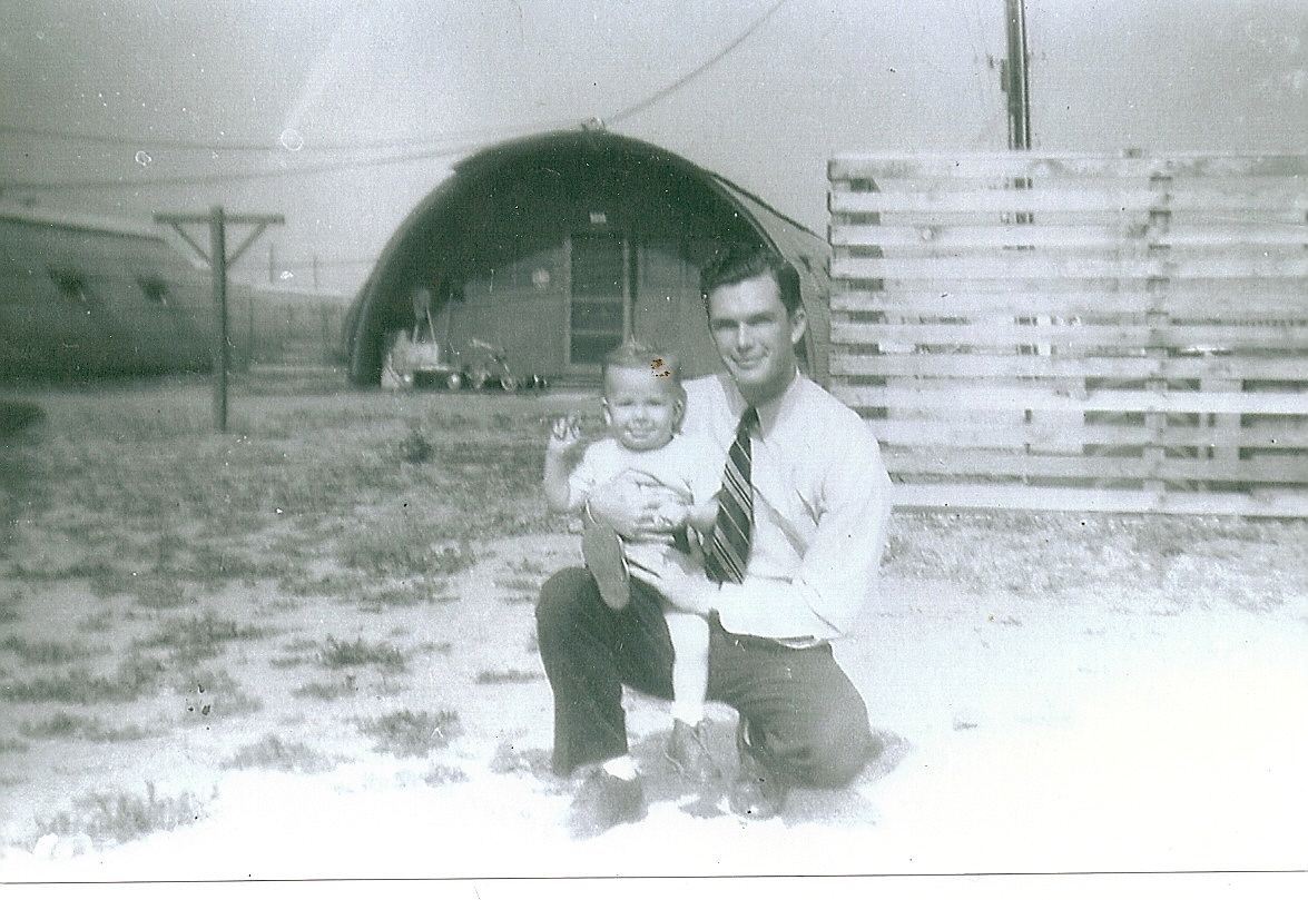photograph of Frank Dumas holding his nephew